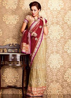 Charming Beige Embroidered Net Lehenga Saree